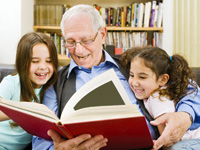 senior and children reading