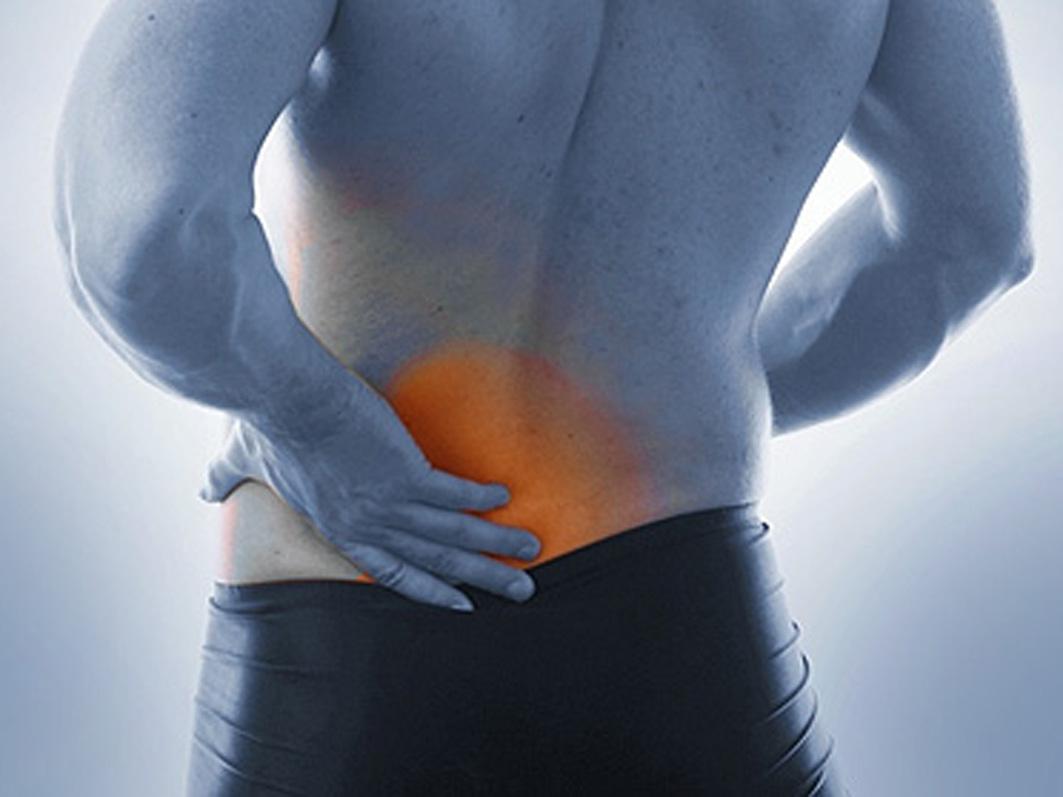 Боль в области копчика у женщин: причины, проявления и лечение