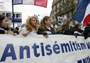 People march through Paris to protest against racism and anti-Semitism following the torture and kil..