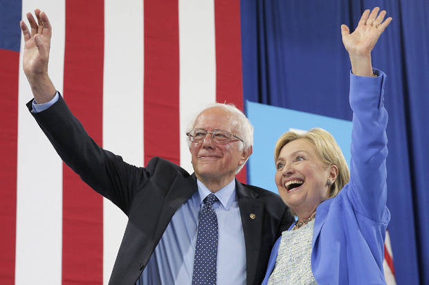 Democratic U.S.  presidential candidates Hillary Clinton and Sen. Bernie Sanders stand together during a campaign rally where Sanders endorsed Clinton in Portsmouth, New Hampshire, U.S., July 12, 2016.  REUTERS/Brian Snyder -  TPX IMAGES OF THE DAY  - RTSHLO5