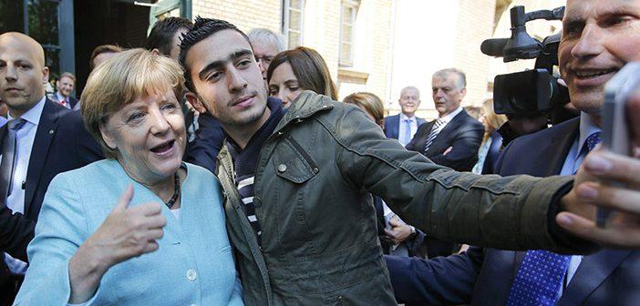 Селфи мигранта с канцлером Германии Ангелой Меркель
