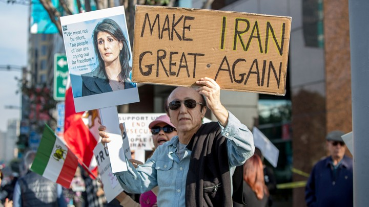 FILE PHOTO: People rally in support of Iranian anti-government protests in Los Angeles, California, U.S. January 7, 2018.  REUTERS/Monica Almeida/File Photo - RC1106F61E20