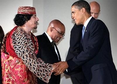Барак Обама и Муаммар Каддафи