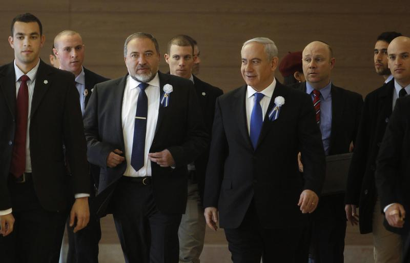 Israel's Prime Minister Benjamin Netanyahu and former foreign minister Avigdor Lieberman (3rd L) arrive to a Likud-Beitenu faction meeting at parliament in Jerusalem February 5, 2013. Israel's President Shimon Peres on Saturday formally called on Netanyahu to assemble a new coalition following the Jan. 22 general election in which Netanyahu's rightist Likud-Beitenu emerged as the biggest party. REUTERS/Baz Ratner (JERUSALEM - Tags: POLITICS) - RTR3DDD4