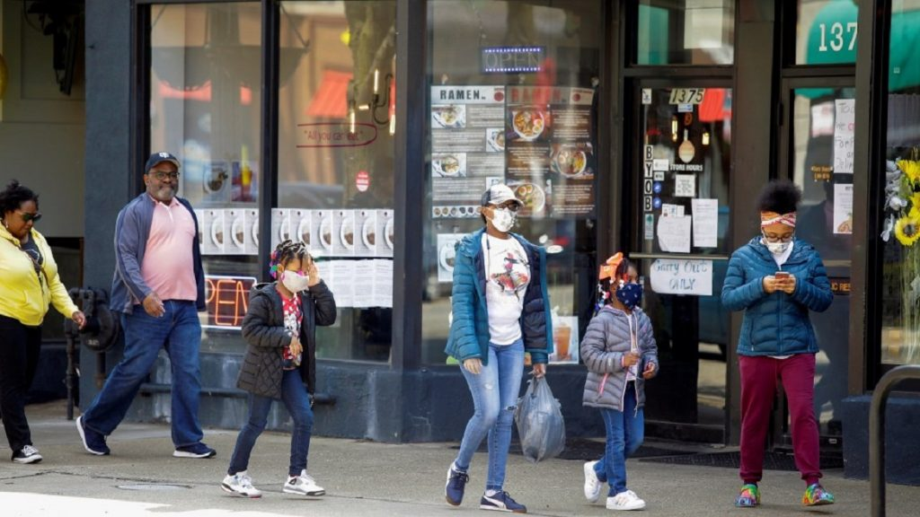 People walk along 53rd Street during the global outbreak of coronavirus disease (COVID-19) in Chicago, Illinois, U.S. April 7, 2020. REUTERS/Joshua Lott