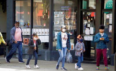 People walk along 53rd Street during the global outbreak of coronavirus disease (COVID-19) in Chicago, Illinois, U.S. April 7, 2020. REUTERS/Joshua Lott