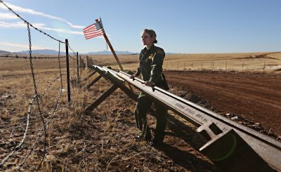 SONOITA, AZ - FEBRUARY 26:  A U.S. Border Patrol agent looks into Mexico from the U.S.-Mexico border on February 26, 2013 near Sonoita, Arizona. The Federal government has increased the Border Patrol presence in Arizona, from some 1,300 agents in the year 2000 ro 4,400 in 2012. The apprehension of undocumented immigrants crossing into the U.S. from Mexico has declined during that time from 600,016 in 2000 to 123,000 in 2012.  (Photo by John Moore/Getty Images)