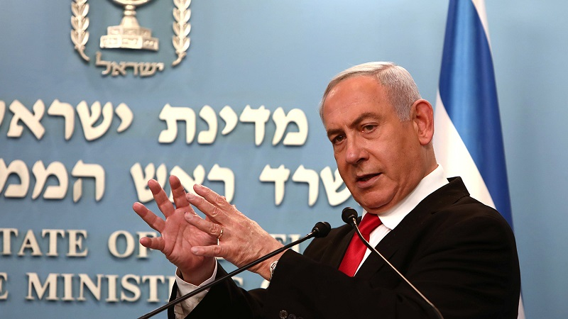 Israeli Prime Minister Benjamin Netanyahu delivers a speech at his Jerusalem office