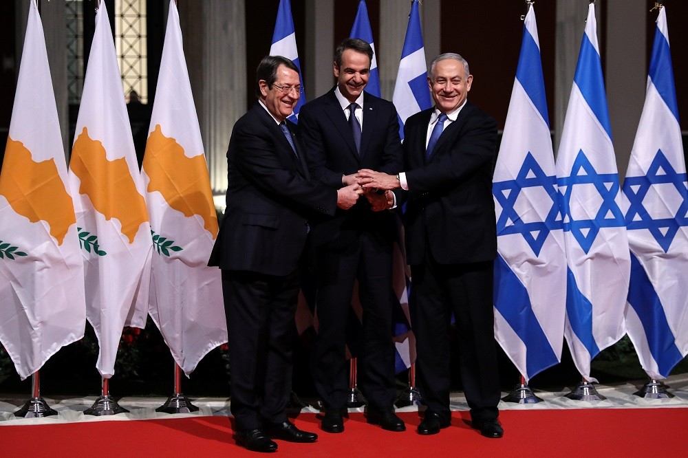 (From L to R) Cypriot President Nicos Anastasiades, Greek Prime Minister Kyriakos Mitsotakis and Israeli Prime Minister Benjamin Netanyahu pose for a photo before signing a deal to build the EastMed subsea pipeline to carry natural gas from the eastern Mediterranean to Europe, at the Zappeion Hall in Athens, Greece, January 2, 2020. REUTERS/Alkis Konstantinidis