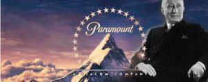 Адольф Цукор на фоне логотипа компании Paramount. yandex.com/images