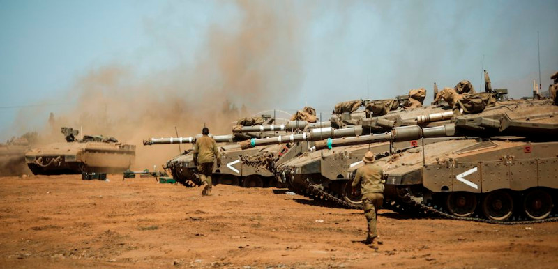 Israeli soldiers manuever Merkava tanks and Namer armored personnel carriers (APCs) during the last day of a military exercise in the northern part of the Israeli-annexed Golan Heights on September 13, 2017.  Israel's military began in September 2017 a massive exercise simulating conflict with Hezbollah, the largest drill in nearly two decades. / AFP PHOTO / JALAA MAREY        (Photo credit should read JALAA MAREY/AFP/Getty Images)