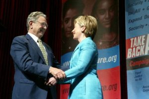 WASHINGTON - JUNE 3:  Philanthropist George Soros (L) greets U.S. Senator Hillary Clinton (D-NY) after she introduced him at the Take Back America Conference June 3, 2004 in Washington, DC. The conference aims to unite progressive issue groups as well as train for organizing campaigns in 2004 and beyond.  (Photo by Matthew Cavanaugh/Getty Images)