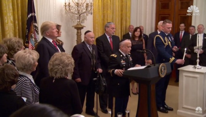 hanukkah light in White House - with survivors