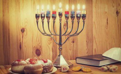 Jewish Holiday Hanukkah With Menorah, Torah, Donuts And Wooden D