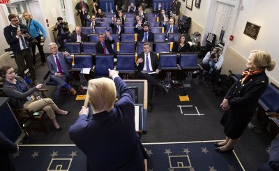 President Donald Trump points to a reporter to ask a question as he speaks about the coronavirus, with Dr. Deborah Birx, White House coronavirus response coordinator, at right, in the James Brady Press Briefing Room of the White House, Tuesday, March 31, 2020, in Washington. (AP Photo/Alex Brandon)