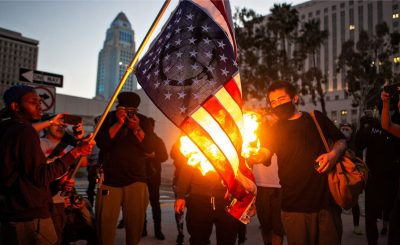 American Flag burned in LA-GettyImages-1215858413