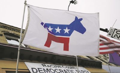 A flag with a logo of the Democratic Party flies over the office of the Racine County Democratic Party in Racine